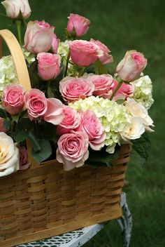 Place freshly cut flowers in a low vase with wet flower foam and place into a basket for an easy centerpiece. Or place potted flowers directly into a basket with a dish to catch the water.