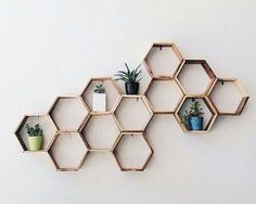 Wooden hexagon shelves mounted to the wall. Useful honeycomb art. - Wood Bookcases - Ideas of Wood Bookcases - Wooden hexagon shelves mounted to the wall. Useful honeycomb art. Diy Room Decor, Bedroom Decor, Home Decor, Wall Art For Bedroom, Succulent Wall Art, Hexagon Shelves, Honeycomb Shelves, Hanging Wall Art, Diy Wall