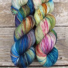 Celebration begins with shades and tones of celery green, then we add flashes of indigo blue, golden-reddish brown, yellow, and reddish-pink. While we call this a ‰Û÷Repeatable Babette‰۪, every skein