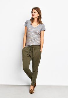 """We love a foil print tee and this season we're adding a classic metallic stripe to our collection. Team this cool basic with denim for an effortless daytime look. •Relaxed fit. Try your usual size. •Metallic stripe detail. •Slips on over the head. •V-neck with rolled capped sleeves. •Sits on the hip. •Lightweight cotton. •Length 64cm (size S). •Model is 5'9"""" and wears size S."""