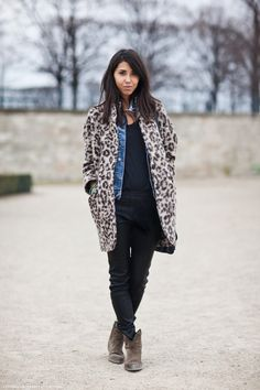denim layered under patterned coat + black leather + rugged boots
