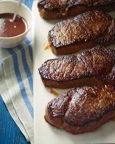 New York Strip Steaks with Red-Wine Sauce - Martha Stewart Recipes. No grill required, done on the stovetop in skillet