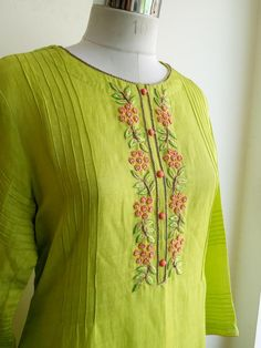 Fresh leaf green Kurta in Linen Silk with Intricate Knot work and Pintucks Detailing. Fabric: Linen Silk  Lining: Cotton