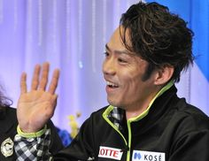 Daisuke Takahashi of Japan reacts after his performance in the men's short program skating event at the NHK Trophy, the fourth leg of the si...