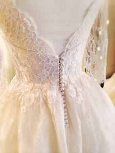 Joanne Fleming Design; Ivory French lace and silk low back 3/4 sleeve tea-length wedding dress