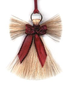 "Made in the USA. Each of our Cowboy Collectibles horsehair ornaments are tagged with a 1/8"" satin sash and are decorated with an assortment of colored ribbons. Creme colored horse hair is featured wit"