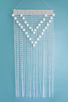 Pom Pom Wall Hanging — Simple to make and so cute!