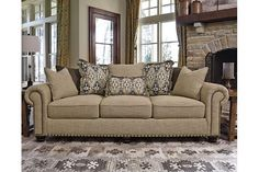 Breathing new life into a familiar profile, the Ilena sofa is everyday classic—with a casually cool attitude. In lieu of traditional back cushions you'll find a bevy of designer pillows for a more relaxed sensibility, while UltraPlush seat cushions offer optimal comfort. Nailhead trim punctuating the sofa's rim and rolled arms are richly tailored touches. Upholstery's wide herringbone weave is sure to please those who appreciate a neutral hue loaded with visual texture.