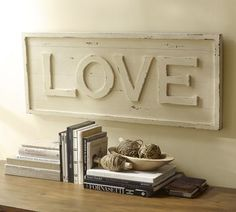 Could make this... using the Wood Letters from the Craft store & some Spray paint, Sand paper & stain. -Could also do your Last name instead...