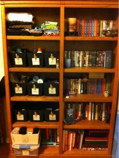 bookshelf repurposed to create craft organization space.