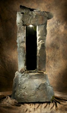 An amazing hand carved concrete water feature. I think this would be great in a cellar.