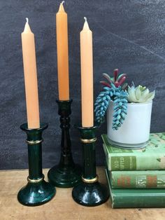 Green Glass Candlestick Holders Collection Of Three Holiday Table Decor A trio of mismatched candlestick holders in deep forest green. Glass Candlestick Holders, Vintage Candle Holders, Glass Candlesticks, Planter Table, Apothecary Bottles, Farmhouse Kitchen Decor, Holiday Tables, Hunter Green, Handmade Items