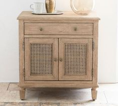 A refined global style defines our Sausalito Collection. With ample hidden storage, the nightstand features a wide top drawer; the lower cabinet houses an adjustable shelf. Caned panels and a Seadrift finish give the nightstand its relaxed, sun-dr… Pottery Barn Bedrooms, Wooden Bedroom, Black Bedroom Furniture, Small Furniture, Furniture Layout, Furniture Sets, Reclaimed Wood Nightstand, Small Nightstand, Nightstands