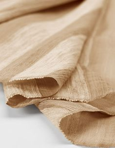 NO. 1728 - SAHARA A honey-hued textile with a quiet sheen. Lush and luxurious, its design features textured horizontal bands that bring out the weave's beautiful, soft luster. Sand warp threads. Horizontal bands will not align on shades installed side-by-side.