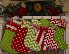 4 Christmas stockings personalized in bright red and green cotton on Etsy, $100.00