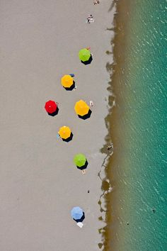 Aerial view of colorful umbrellas on the beach of the new Riemer lake in Munich-Riem Germany