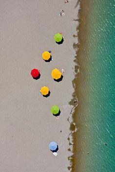 Aerial view of colorful umbrellas on the beach  [ AutonomousAvionics.com ] #Aerial #avionics #technology