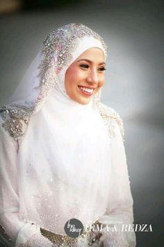 Muslim bride. Dress & matching veil by Malaysian designer Hatta Dolmat. loving it!
