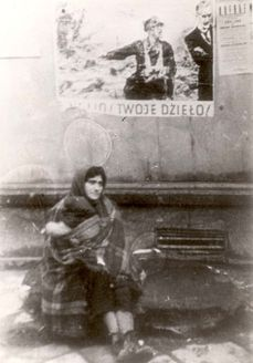 Warsaw, Poland, A woman sitting in the street with a child wrapped in a blanket, with a propaganda placard behind her. She and child did not survive Warsaw Ghetto, Warsaw Poland, Kids Wraps, Jehovah, Ww2, Devil, Don't Forget, Child, Apple