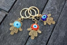 Evil eye beaded keychain with gold plated Hamsa charm.    Large evil eye is handmade with Murano glass.    THE LISTING IS ONLY FOR ONE OF THE