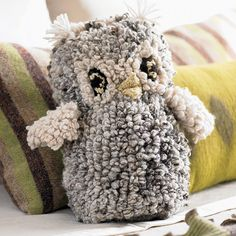 Wooly night owl. Hand-spun and hand-knitted by women in rural Kenya, this huggable owl is dyed with plants grown in the women's gardens. The money they earn pays for glasses when it was discovered that some women were knitting inches away from their eyes because they couldn't see correctly.