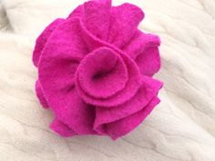A personal favorite from my Etsy shop https://www.etsy.com/listing/206766537/hot-pink-wool-felted-flower-pin-purple