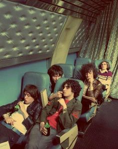 The Strokes - You Only Live Once; sitting, casual form, clothing, faces, expressions, hair, color, group