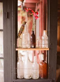 Shelf in the window with antique bottles