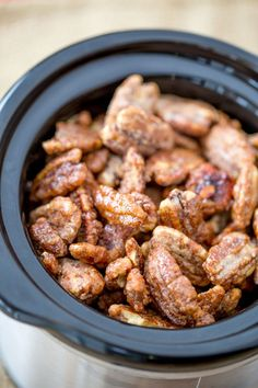 Slow Cooker Candied Cinnamon Pecans are a total breeze to make and will leave your house smelling delicious. They double as amazing holiday gifts!