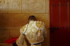 Spanish matador Javier Jimenez stretches before a bullfight at the Real Maestranza bullring in the Andalusian capital of Seville