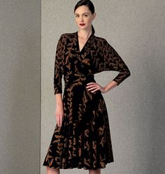 V1405 Pullover, lined dress has close-fitting, mock-wrap, front bodice extending into back collar, draped midriff with stays, invisible back zipper, below elbow sleeves and narrow hem. Purchased elastic, slides and rings for shoulder straps on bodice lining, and bias tape to finish zipper. #voguepatterns