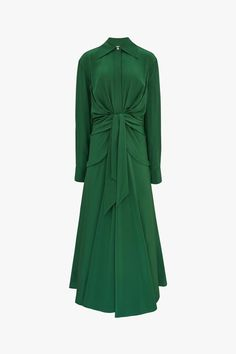 Cut from silk crepe de chine, this shirt dress features a draped front panel that wraps into a self-tie detail that elegantly defines the waist. Stylish Dresses, Elegant Dresses, Dresses For Work, Work Outfits, Dress Outfits, Green Outfits For Women, Green Shirt Dress, Silk Shirt Dress, Iconic Dresses
