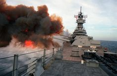 """Smoke billows from the muzzles of the Mark 7 16-inch/50-caliber guns in each of the three main gun turrets aboard the battleship USS MISSOURI (BB-63) after the ship fired multiple slavos during exercise RimPac """"90 near Hawaii."""