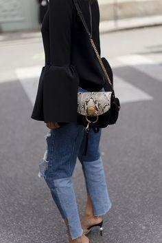 Aimee song of style wearing distressed denim during paris fashion week