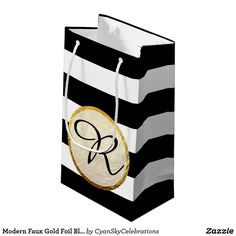 """Modern Faux Gold Foil Black White Stripe Monogram Small Gift Bag Fresh, elegant, and gracefully modern! Designed for a bold visual impact with luxurious style. Please note that the faux gold foil is a printed visual effect only and does not represent real foil texture on the finished product. For most realistic shine, printing with glossy finish is recommended. Easy customization! Simply replace the template text with your own details. Click the """"Customize It"""" button to add text or move and…"""