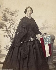 8 by 10 Photo Print Civil War Smiling Woman Holding 11 Star Confederate Flag- much of this ladies attire gives the impression of being of mourning, question is, whom is she mourning. the main question I have is it photo shoped as well as coloured Confederate States Of America, Confederate Flag, Historical Clothing, Historical Photos, Civil War Dress, War Image, Civil War Photos, Victorian Women, Victorian Dresses