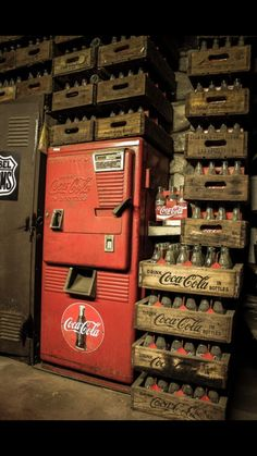 Coca-Cola machine with bottles stacked in wooden crates ~ at every gas station we stopped at when traveling as kids!