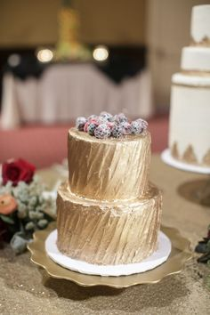Metallic gold cake with bright pretty berries: http://www.stylemepretty.com/louisiana-weddings/new-iberia/2015/10/05/whimsical-summer-wedding-at-rip-van-winkle-gardens/ | Photography: Greer G. Photography - http://www.greergphotography.com/