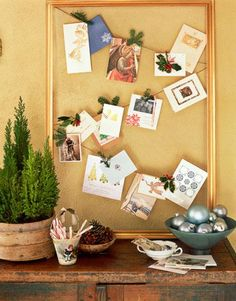 Sprigs of holly make a holiday-card display even more festive.