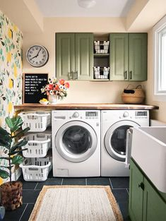 Green Paint Colors Our Editors Swear ByStep away from white cabinets and into something a little more colorful. In this laundry room, muted forest green cabinets pair with an eclectic mix of wood and Laundry Room Remodel, Laundry Room Organization, Laundry Room Design, Laundry Room Colors, Basement Laundry, Colorful Laundry Rooms, Laundry Room With Storage, Laundry Room With Cabinets, Laundry Room Bathroom