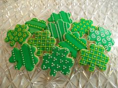 St. Patrick's Day decorated sugar cookies. Royal icing. Green, yellow, white. Shamrock. Polka dots, stripes, lattice.
