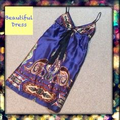 Reduced Beautiful Silky dress Beautiful silky dress can be dressed up or down. Bought in a boutique but no tag inside. Possibly hand made. Fully lined and perfect condition. Worn once. Dresses