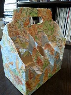 Gift carrier for wine  bottles - made from simple supermarket  paper carrier, old school atlas bought in second-hand bookstore and half bottle of hobby glue