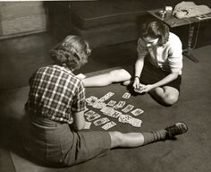Students playing cards in their dorm room at Vassar College, 1940s.