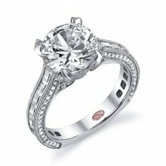 DemarcoJewelry.com  Capture her grace and endless beauty with this confident yet elegant design. We have also incorporated a unique pink diamond with every single one of our rings, symbolizing that hidden, unspoken emotion and feeling one carries in their heart about their significant other. This is not just another ring, this is a heirloom piece of jewelry.   Demarco Bridal Engagement Ring.