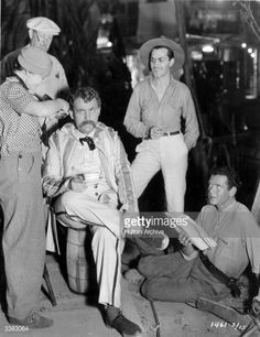 Actors Charles Laughton (1899 - 1962), Kent Taylor (1907 - 1987) and Charles Bickford (1889 - 1967), prepare to shoot the film 'White Woman', directed by Stuart Walker for Paramount.