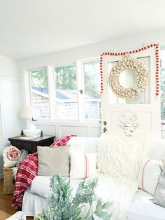 Neutral Farmhouse Christmas Decor: White living room dressed in affordable reds for Christmas {by Luc & Lilah Events}