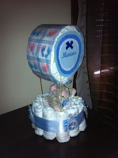 One version of hot air balloon Baby Shower Crafts, Baby Crafts, Baby Shower Decorations, Shower Gifts, Carnival Baby Showers, Diaper Crafts, Diaper Bouquet, Baby Hamper, Little Presents