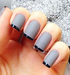 Gray nail polish with thin black French tips. A very classic looking nails art that you can easily recreate and pant on just about any season.