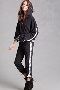 A pair of French terry knit sweatpants by Private Academy™ featuring an elasticized drawstring, a ribbed waistband with varsity stripes, contrasting sides with elasticized strappy lace-up sides, and elasticized cuffs.